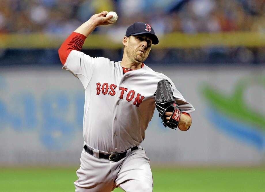 The Boston Red Sox traded pitcher John Lackey on Thursday. Photo: Chris O'Meara — The Associated Press  / AP