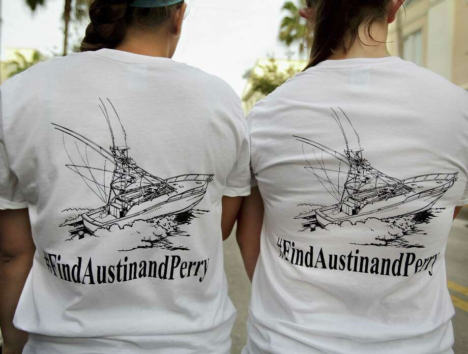 Girls wear T-shirts they bought to help fund the ongoing private search for Nick Cohen and Austin Stephanos who have been missing since they took their boat out of the Jupiter Inlet, Friday, during a fundraiser at Jumby Bay Island Grill, Wednesday in Jupiter, Fla. Photo: Richard Graulich/The Palm Beach Post Via AP  / The Palm Beach Post