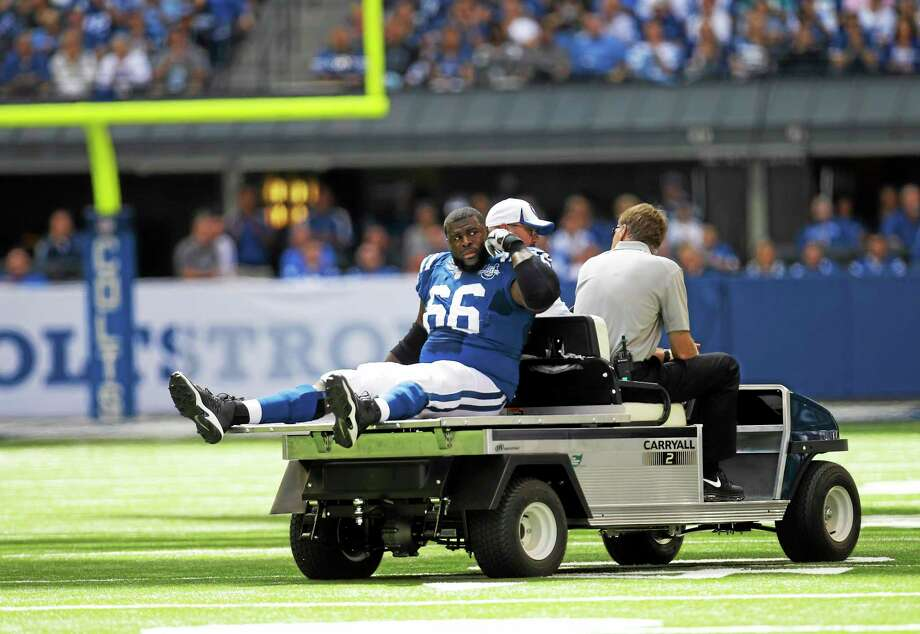 Colts lineman Donald Thomas (66) of West Haven is helped off the field after getting injured during a Sept. 15, 2013 game in Indianapolis. Photo: AJ Mast — The Associated Press File Photo  / AP2013