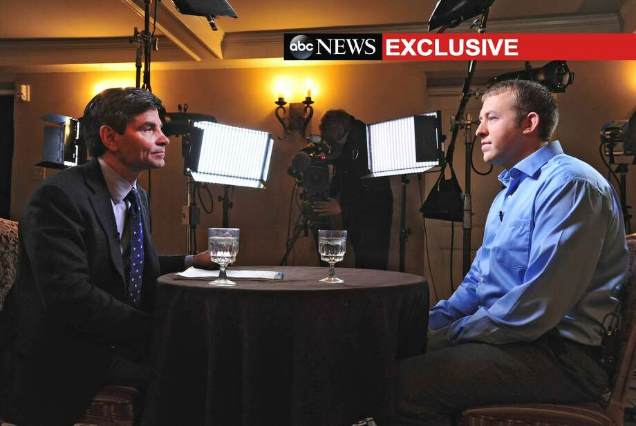 In this photo provided by ABC News, ABC News' chief anchor George Stephanopoulos, left, interviews Ferguson, MO., police officer Darren Wilson, Tuesday, Nov. 25, 2014 in Missouri. The interview will air during ABC News programs and platforms on Nov. 25 and 26. Photo: (AP Photo/ABC News, Kevin Lowder)  / ABC News