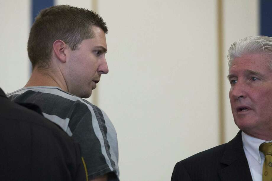 Former University of Cincinnati police officer Ray Tensing, left, glances towards his lawyer Stewart Mathews after appearing at Hamilton County Courthouse for his arraignment in the shooting death of motorist Samuel DuBose on July 30, 2015, in Cincinnati. Tensing, who was indicted and fired from his job on Wednesday, shot and killed Dubose on July 19. Photo: AP Photo/John Minchillo  / AP