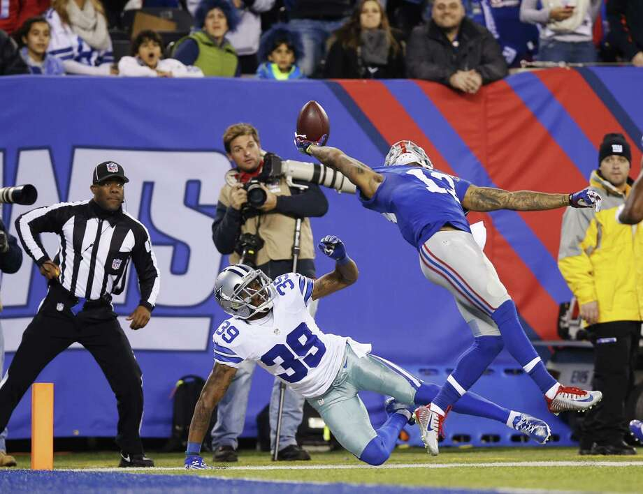 Kathy Willens — The Associated Press Giants wide receiver Odell Beckham Jr. (13) makes a one-handed catch for a touchdown in the second quarter Sunday. Photo: AP / AP