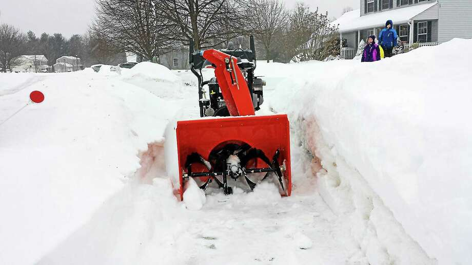 A snow blower is used to clear a sidewalk during the recent storm. Photo: Submitted Photo
