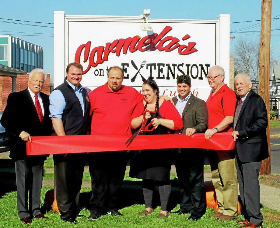 From left are Middletown Small Business Development Center Counselor Paul Dodge, Mayor's chief of staff Joseph Samolis, Matt and Carmela Lockwood, owners of Carmela's on the Extension, which held its grand opening last week; Middletown Mayor Dan Drew, Chamber Central Business Bureau Chairman Thomas Byrne, and Middlesex County Chamber of Commerce President Larry McHugh. Photo: Courtesy Photo