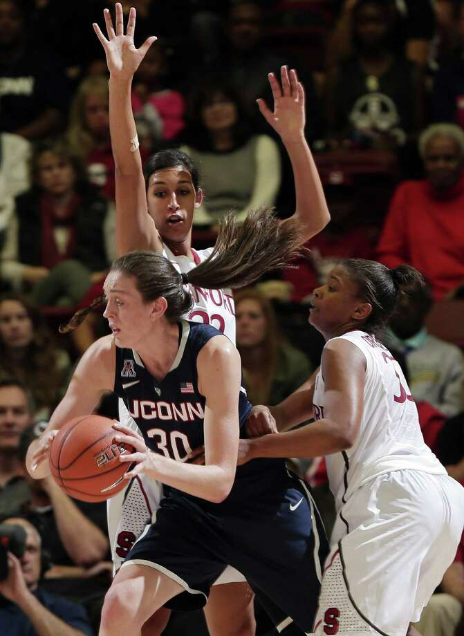 Connecticut forward Breanna Stewart (30) is guarded by Stanford forward Kailee Johnson, top, and guard Amber Orrange, right, during the second half of an NCAA college basketball game on Monday, Nov. 17, 2014, in Stanford, Calif. Stanford won 88-86 in overtime. (AP Photo/Marcio Jose Sanchez) Photo: AP / AP