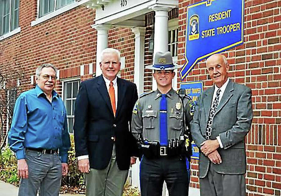 From left are: David Burgess, former Middlefield selectman; Middlefield's newly elected First Selectman Ed Bailey; Trooper Tim Kendrick, and  Selectman Jon Brayshaw, former first selectman. Photo: Courtesy Photo