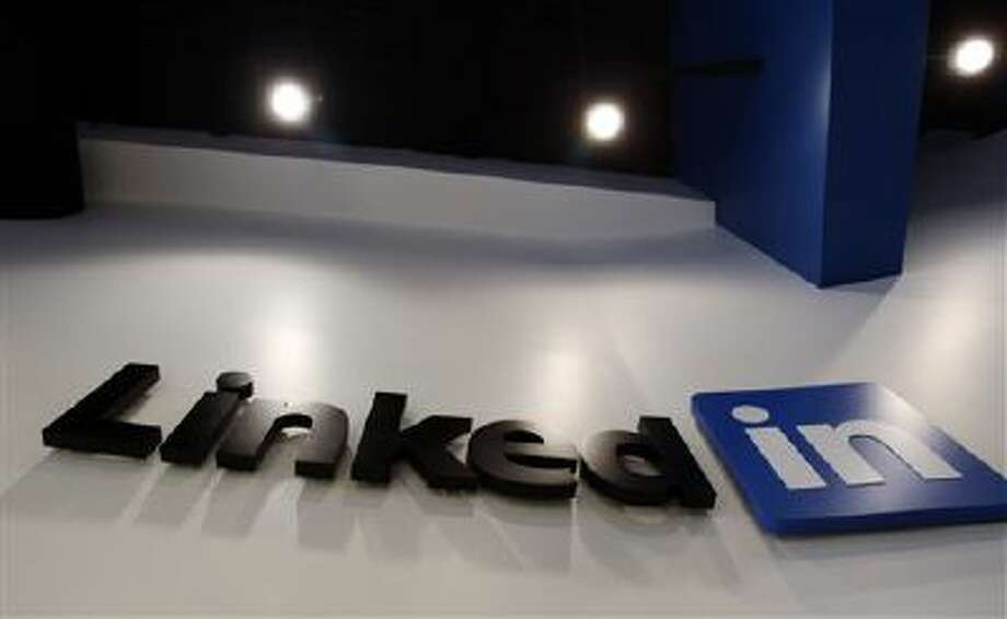 The LinkedIn logo is displayed in the foyer at headquarters in Mountain View, Calif. Photo: AP / AP