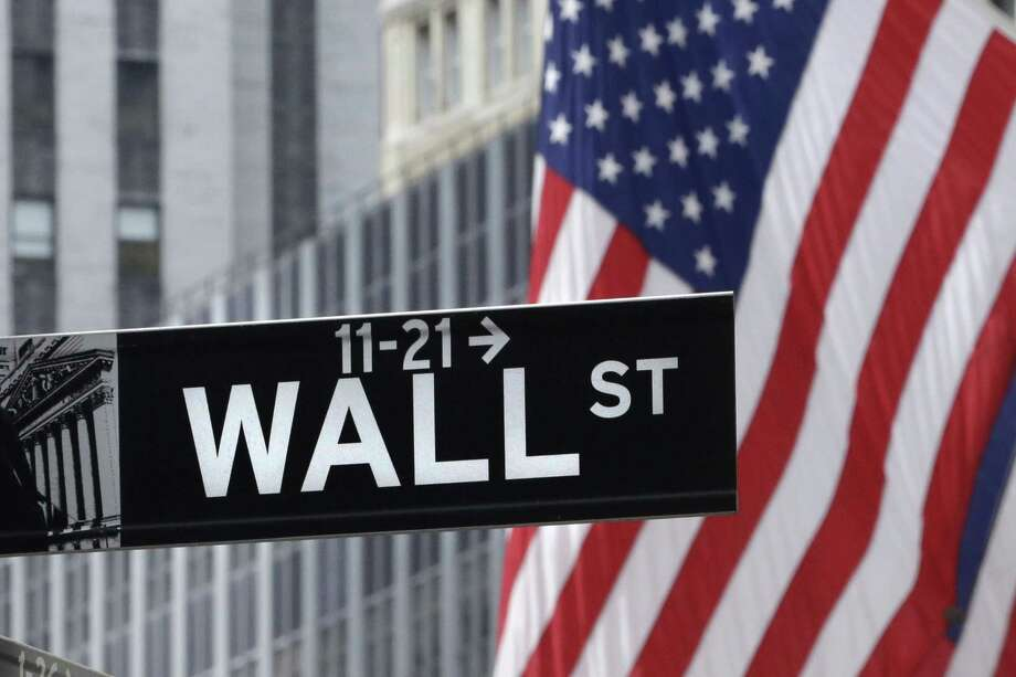 This July 6, 2015 photo shows a Wall Street sign near the New York Stock Exchange. Most major global markets rose Thursday, July 30, 2015, after the U.S. Federal Reserve left interest rates unchanged at a record low, corporate earnings mostly did better than expected and investors awaited U.S. economic growth figures. Photo: Mark Lennihan — The Associated Press  / AP