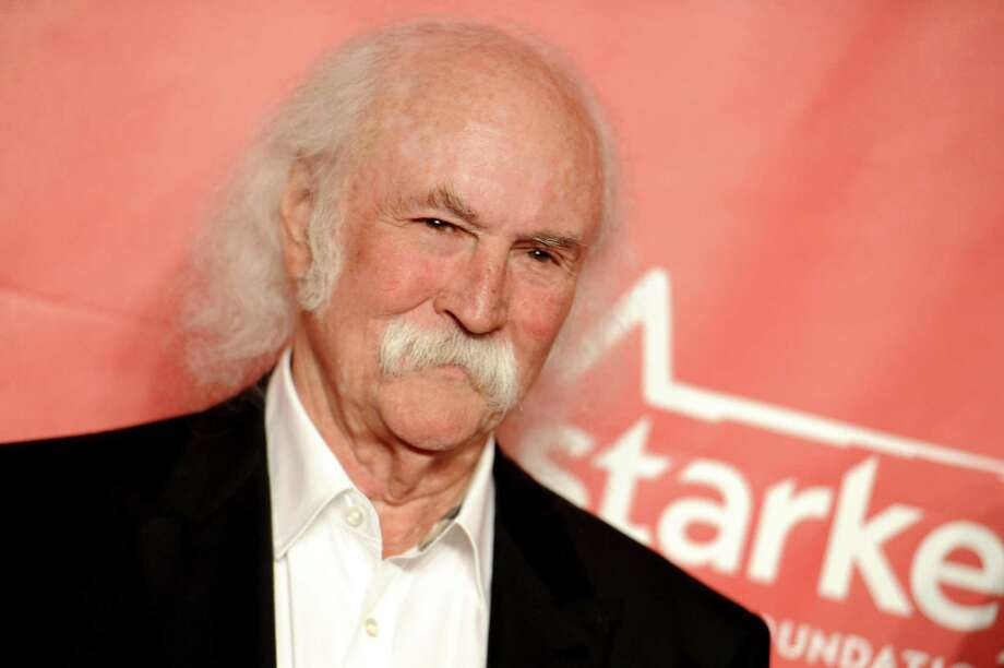 FILE - In this Feb. 6, 2015 file photo, David Crosby arrives at the 2015 MusiCares Person of the Year event at the Los Angeles Convention Center in Los Angeles. The Rock and Roll Hall of Famer Crosby hit and injured a jogger with his car in Southern California. The California Highway Patrol said in a statement that Crosby was driving his Tesla electric car Sunday, March 22, 2015, at around 55 mph, the posted speed limit on the road in the Santa Barbara area where Crosby lives. (Photo by Richard Shotwell/Invision/AP, File) Photo: Richard Shotwell/Invision/AP / Invision