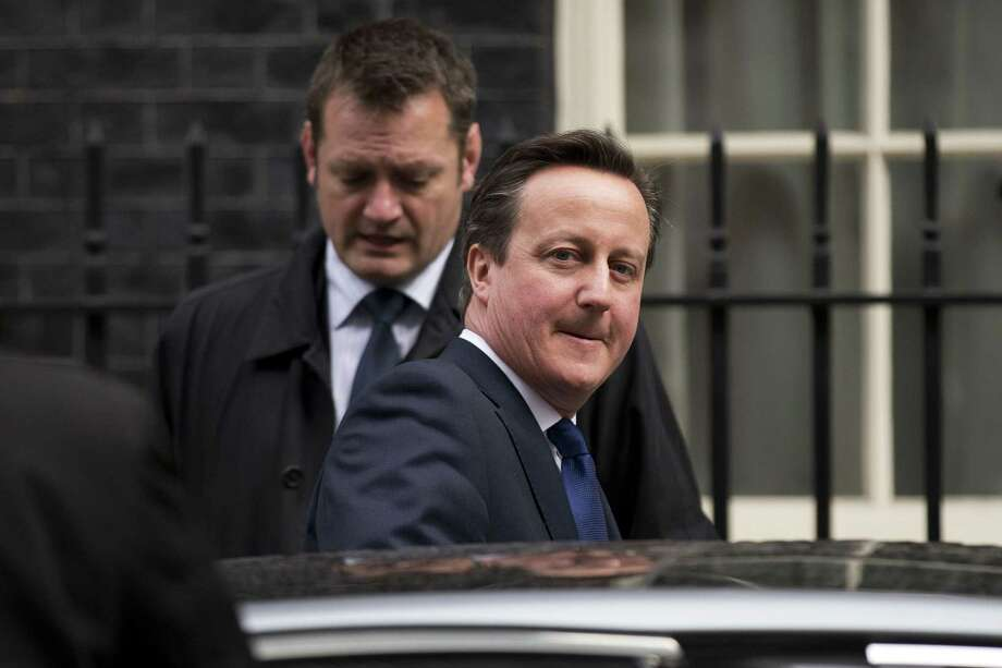 British Prime Minister David Cameron gets in a car as he leaves 10 Downing Street in London, to attend Prime Minister's Questions at the Houses of Parliament, Wednesday, March 25, 2015.  (AP Photo/Matt Dunham) Photo: AP / AP