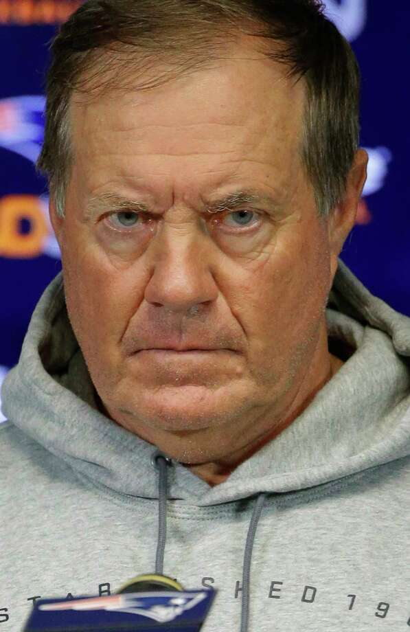 New England Patriots head coach Bill Belichick refuses to answer reporters' questions concerning NFL Commissioner Roger Goodell's action upholding quarterback Tom Brady's four-game suspension during a training camp media availability on Wednesday in Foxborough, Mass. Photo: Stephan Savoia — The Associated Press  / AP