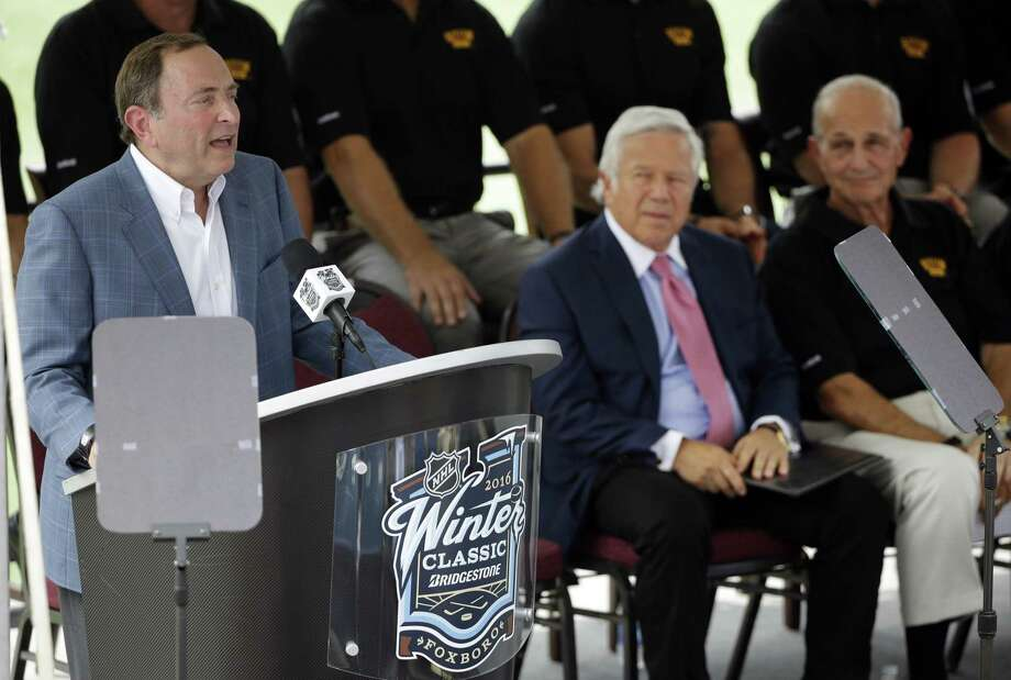 NHL Commissioner Gary Bettman speaks during an event at Gillette Stadium Wednesday in Foxborough, Mass., to promote the NHL Winter Classic between the Montreal Canadiens and Boston Bruins, scheduled to be played on New Year's Day 2016. Seated are New England Patriots owner Robert Kraft, center, and Bruins owner Jeremy Jacobs, right. Photo: Stephan Savoia — The Associated Press  / AP