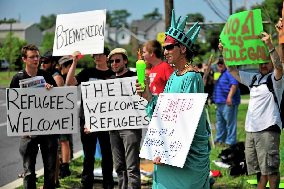 Members of the Industrial Workers of the World Lehigh Valley branch rally outside the KidsPeace Broadway campus in Sunday, July 27, 2014 in Fountain Hill, Pa. in support of the unaccompanied immigrant children who are temporarily housed there. (AP Photo/Chris Post) Photo: AP / FR170581 AP