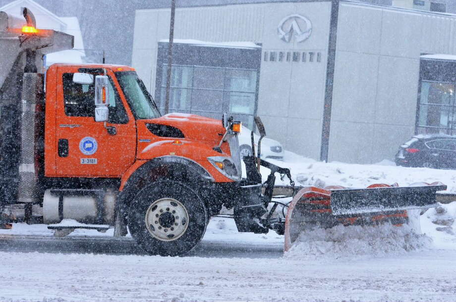 Peter Casolino - Register A plow drives up Route 34 in West Haven as Thursday's storm begins. Photo: Journal Register Co.