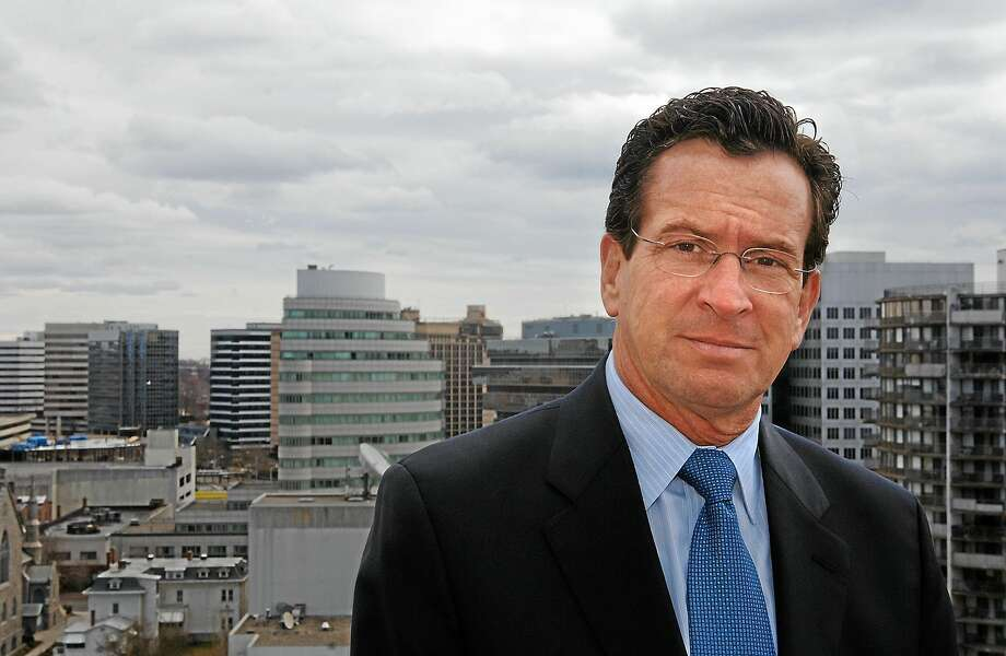 In this AP file photo, former Stamford Mayor Dan Malloy stands atop the city's government center, looking out over neighboring businesses he hopes will become part of a mini-energy district, on Wednesday, April 4, 2012, in Stamford, Conn. Stamford was seeking state legislation to allow businesses and government buildings to team up and create their own energy sources, using the region's traditional power grid only for emergencies. Photo: AP Photo/Fred Beckham   / AP2007