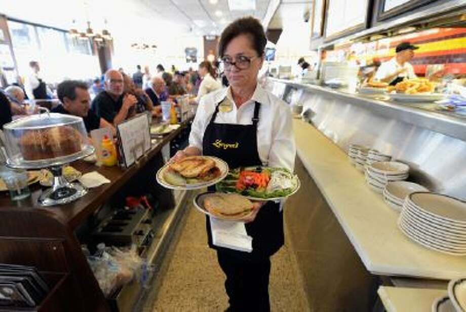 Waitress Sheila Abramson at Langer's Delicatessen serves customers in Los Angeles, Calif. Much of the service industry in America has gone without a raise since 1991.