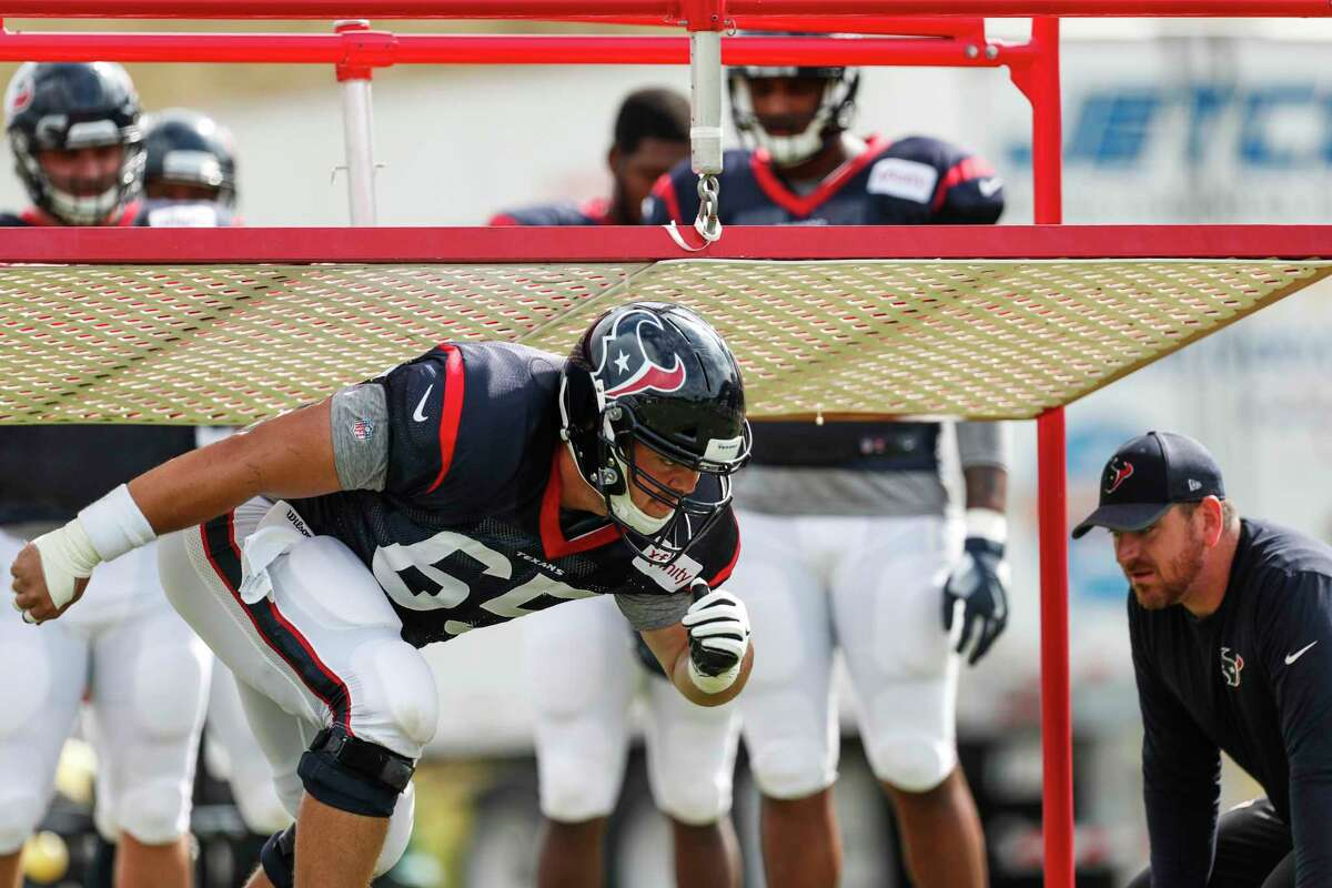 Houston Texans center Greg Mancz (65) fires off the line during a drill during training camp at The Greenbrier on Saturday, Aug. 12, 2017, in White Sulphur Springs, W.Va.
