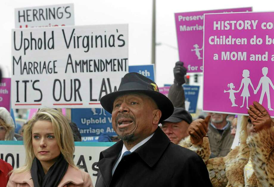 Former Republican candidate for Lt. Gov. E.W. Jackson, front center, speaks to the media during a demonstration outside Federal Court in Norfolk, Va., Tuesday, Feb. 4, 2014. Jackson spoke in favor of the law banning same sex marriage.  (AP Photo/Steve Helber) Photo: AP / AP