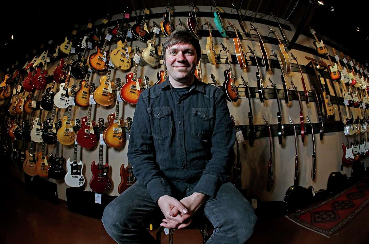 Brian Douglas is photographed at the Cream City Music store in Brookfield, Wis. Cream City Music sells more than 1,800 items from guitar picks to vintage instruments on Reverb.com, a musical equipment marketplace.