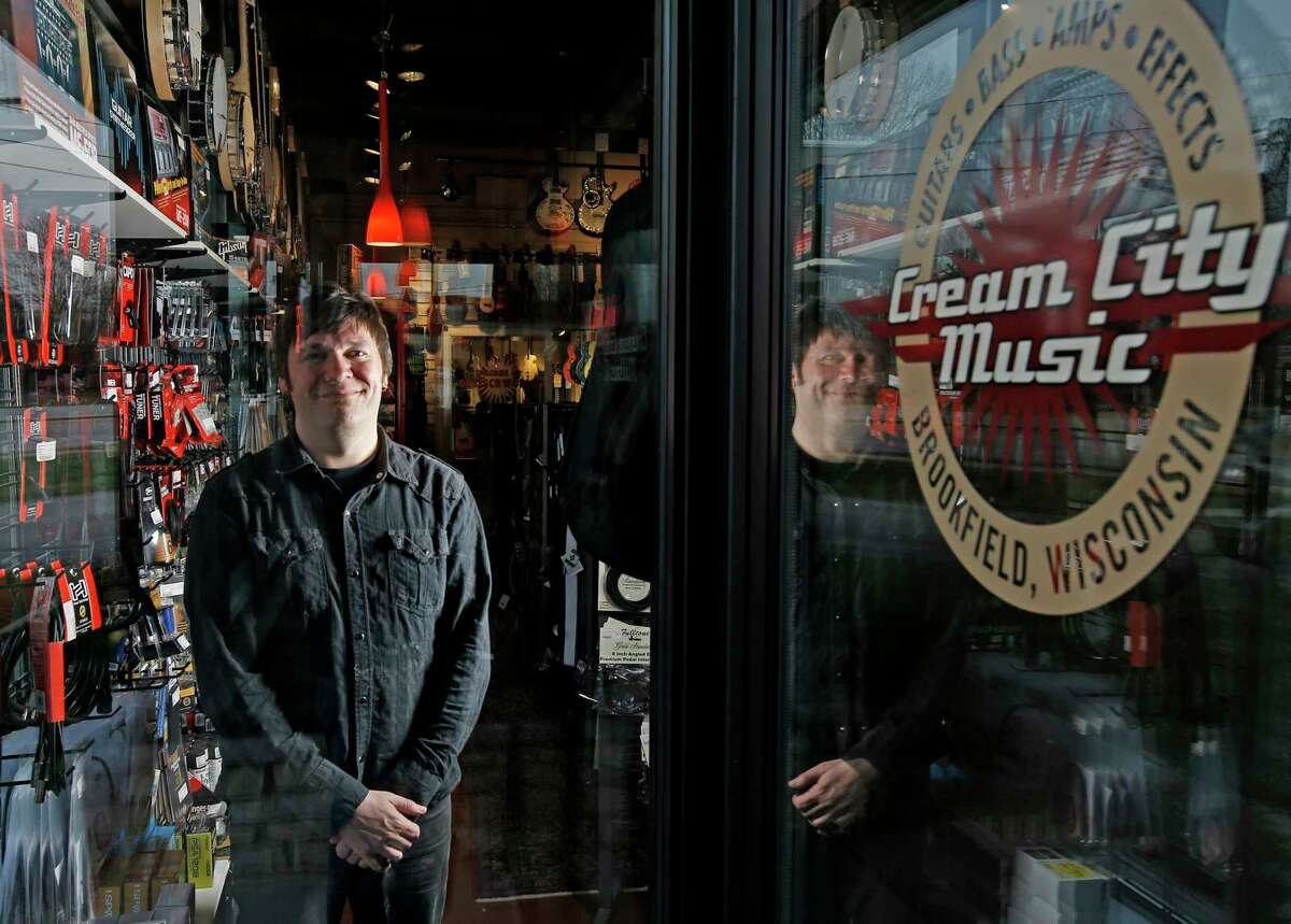 Brian Douglas is photographed at the Cream City Music store in Brookfield, Wis.