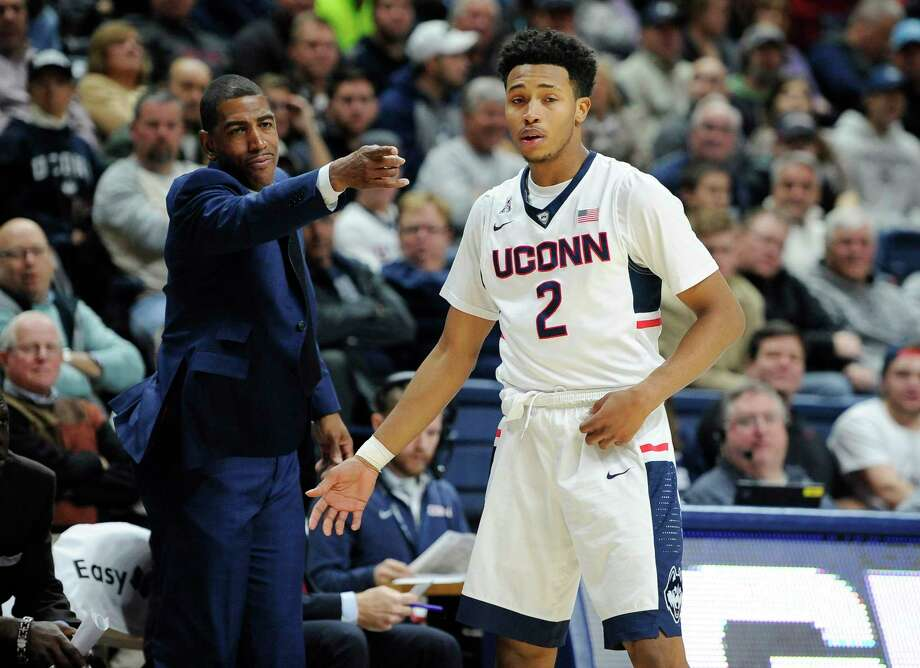 Kevin Ollie, left, Jalen Adams and UConn will host Furman in the Huskies' mainland portion of the Battle 4 Atlantis tournament. Photo: Jessica Hill — The Associated Press  / AP2015