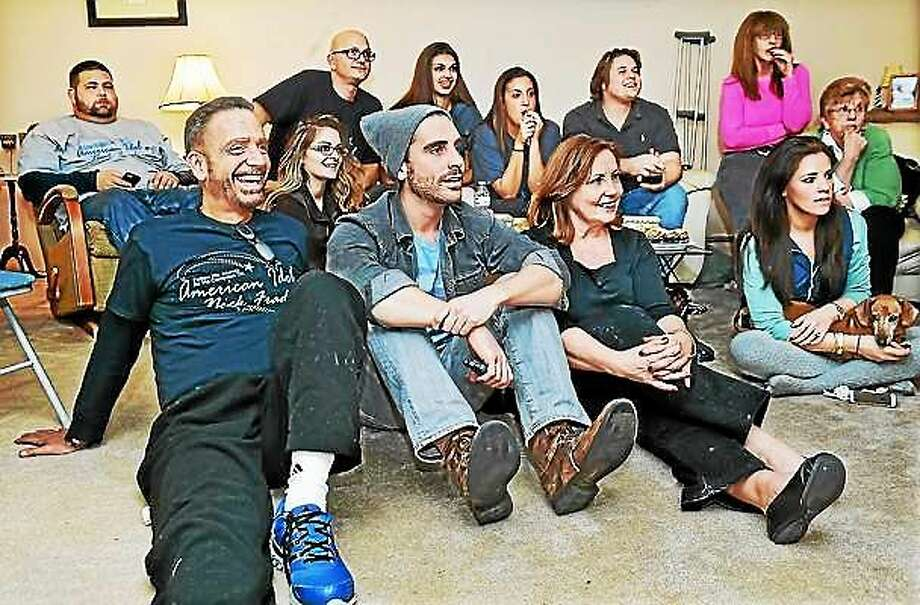 "Nick Fradiani IV, in cap, with his parents, Elizabeth and Nick Fradiani III, and family watch ""American Idol"" in January. Photo: Catherine Avalone — New Haven Register"