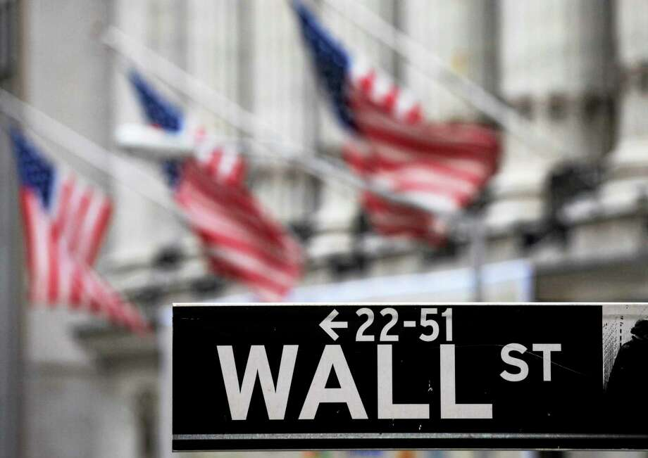 FILE - This April 22, 2010, file photo, shows a Wall Street sign in front of the New York Stock Exchange. U.S. stocks slumped Thursday, July 31, 2014, as investors reacted to disappointing corporate earnings reports and assessed the implications of the approaching end to economic stimulus from the Federal Reserve. Photo: THE ASSOCIATED PRESS / AP