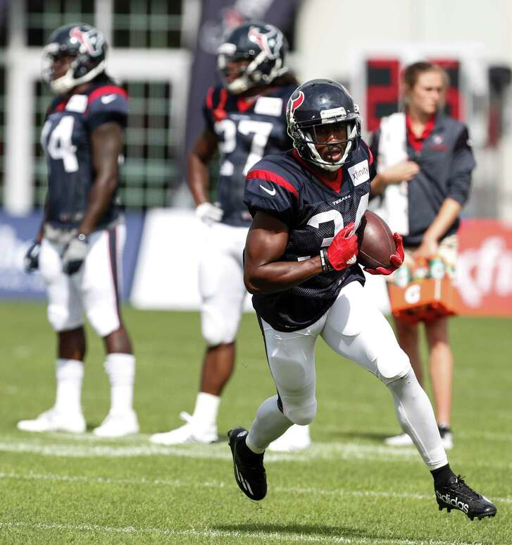 Houston Texans running back Tyler Ervin (34) runs upfield after making a catch during training camp at The Greenbrier on Saturday, Aug. 12, 2017, in White Sulphur Springs, W.Va.