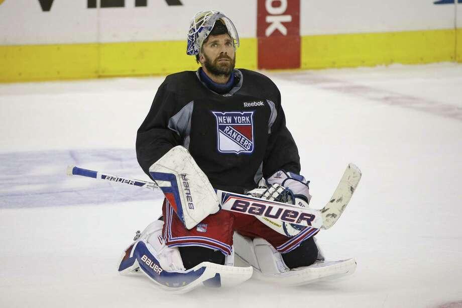 New York Rangers goalie Henrik Lundqvist is back at practice. Photo: Jae C. Hong — The Associated Press  / AP