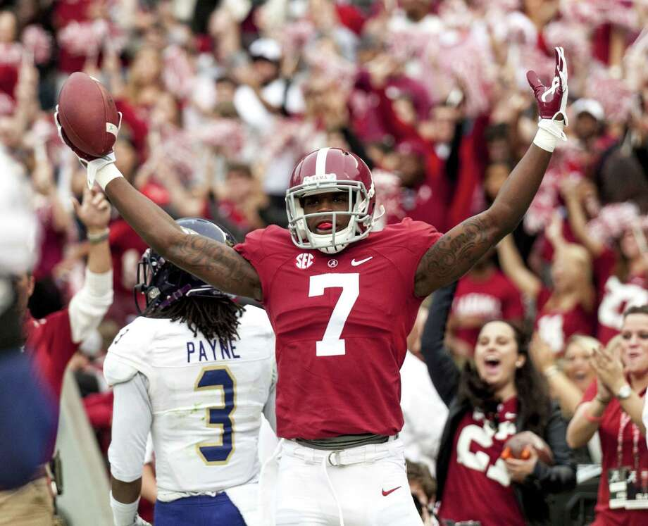 Alabama wide receiver Cam Sims (7) celebrates a touchdown during the first quarter of Saturday's win over Western Carolina. Photo: The Associated Press  / Alabama Media Group