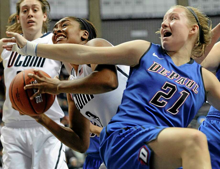DePaul's Megan Rogowski fouls UConn's Morgan Tuck during the second half of a Feb. 10, 2013 game in Storrs. Photo: The Associated Press File Photo  / FR125654 AP