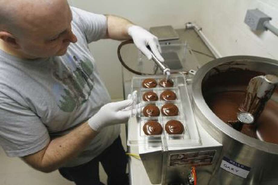 """en Rasmussen, of Woodbridge, Va., uses a winnowing machine to separate the cocoa bean husks from the nibs, which are then put into a machine called a melanger, a French word that means """"to mix."""" Rasmussen also adds sugar."""