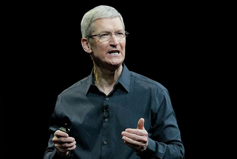 Apple CEO Tim Cook speaks at an event in San Francisco. The deadly attacks in Paris may soon reopen the debate over whether and how tech companies should let the government sidestep the data scrambling that shields everyday commerce and daily digital life alike. Photo: AP File Photo  / AP