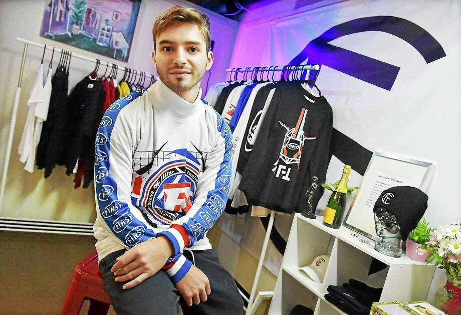 "Dillon Milardo, 21, owner and designer of First Twelve Market at 386 Main Street in Middletown, a senior majoring in fine art at Central Connecticut State University and 2010 graduate of Middletown High School, describes his clothing: ""From the sporting stage to the streets ... we are celebrating the divided cultures of the world as one, translated through pioneering street and sporting design."" Photo: Catherine Avalone — The Middletown Press  / New Haven RegisterThe Middletown Press"