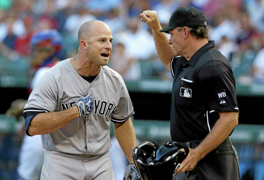New York Yankees Brett Gardner, left, yells at home plate umpire Ed Hickox  after a strike three call against Gardner during the second inning. Photo: LM Otero — The Associated Press  / AP