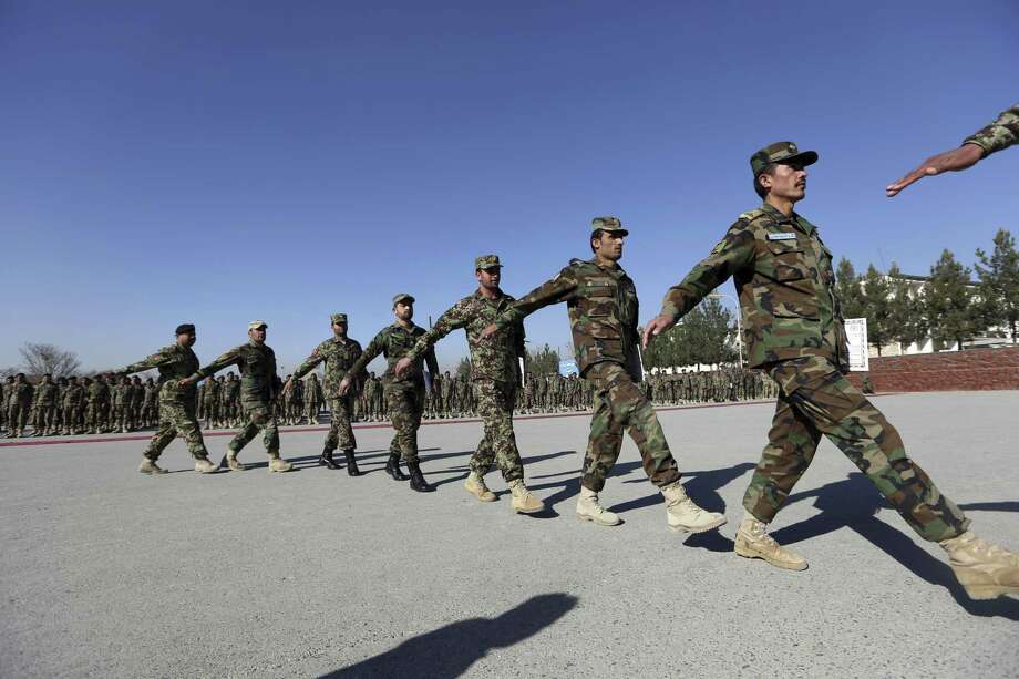 New members of the Afghan National Army march during their graduation ceremony at the Afghan Military Academy in Kabul, Afghanistan, on Nov. 23, 2014. Photo: AP Photo/Rahmat Gul  / AP