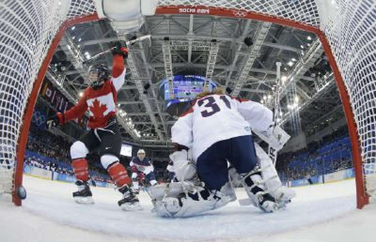 Meghan Agosta-Marciano of Canada celebrates her second goal of the game against USA Goalkeeper Jessie Vetter.