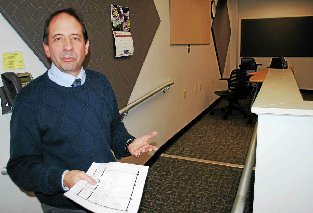 Richard Lenoce, director of the Center for New Media at Middlesex Community College in Middletown, gives a tour of the center and explains where the new student radio station studio will go.