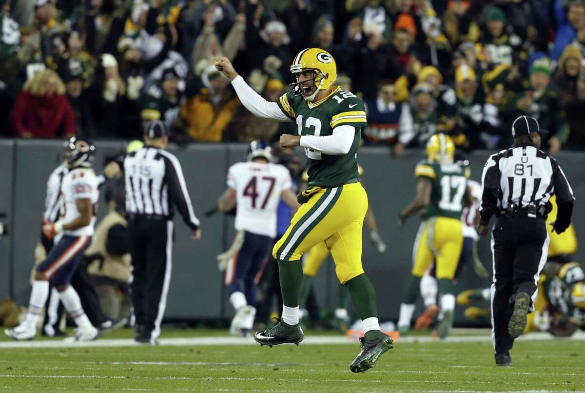Green Bay quarterback Aaron Rodgers celebrates a touchdown during the first half of the Packers' win over the Chicago Bears on Nov. 9 in Green Bay, Wis.