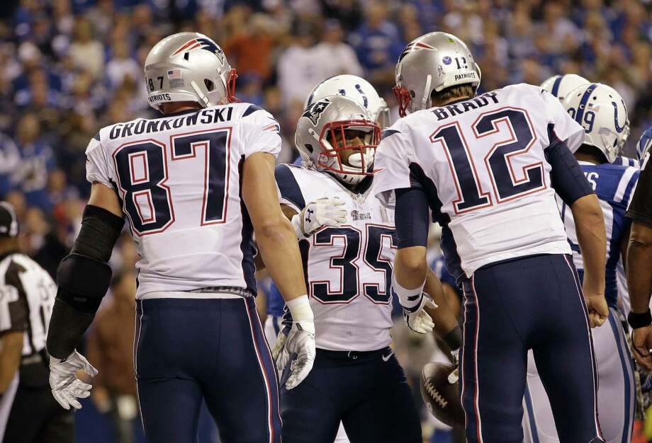 Rob Gronkowski, Tom Brady and the Patriots will be tested when they host the league's top defense on Sunday in Foxborough, Mass. Photo: The Associated Press  / FR123854 AP