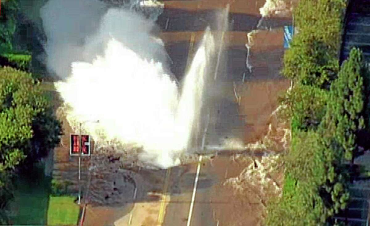 In this photo taken from video provided by nbc4la.com, water reaches into the air after a water main burst on Sunset Boulevard in Los Angeles near UCLA Tuesday, July 29, 2014. (AP Photo/nbc4la.com) MANDATORY CREDIT