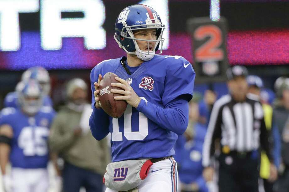 After throwing five interceptions in a loss to the 49ers last week, Eli Manning will look to bounce back against the rival Cowboys Sunday night. Photo: Julio Cortez — The Associated Press  / AP