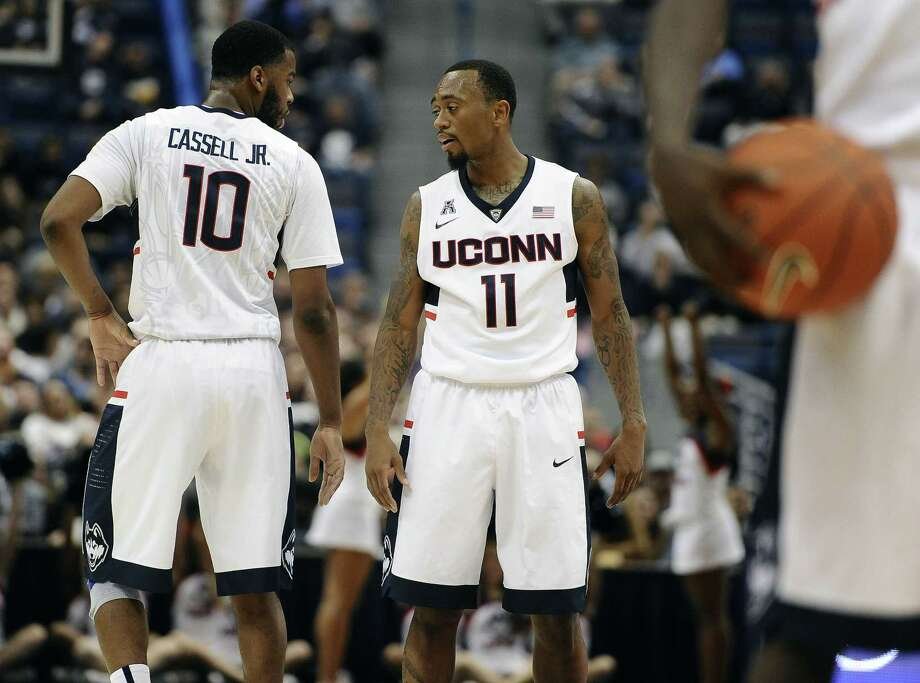 Ryan Boatright (11) decommitted from West Virginia before signing with UConn. On Sunday, Boatright and the Huskies face coach Bob Huggins and the Mountaineers. Photo: Jessica Hill — The Associated Press  / AP2014