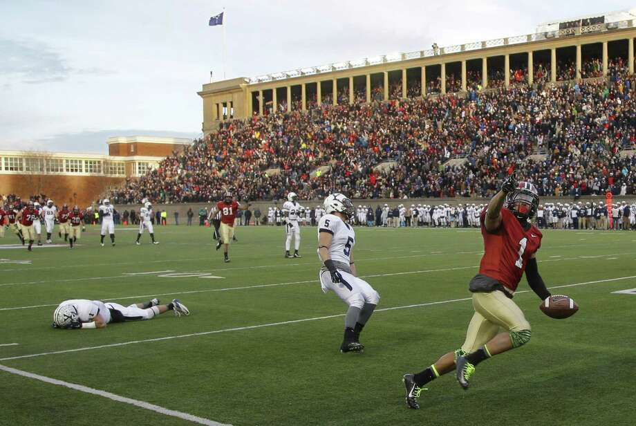 Harvard receiver Andrew Fischer runs into the end zone for a late fourth-quarter touchdown against Yale in the Crimson's 31-24 win on Saturday afternoon at Harvard Stadium in Cambridge, Mass. Photo: Stephan Savoia — The Associated Press  / AP