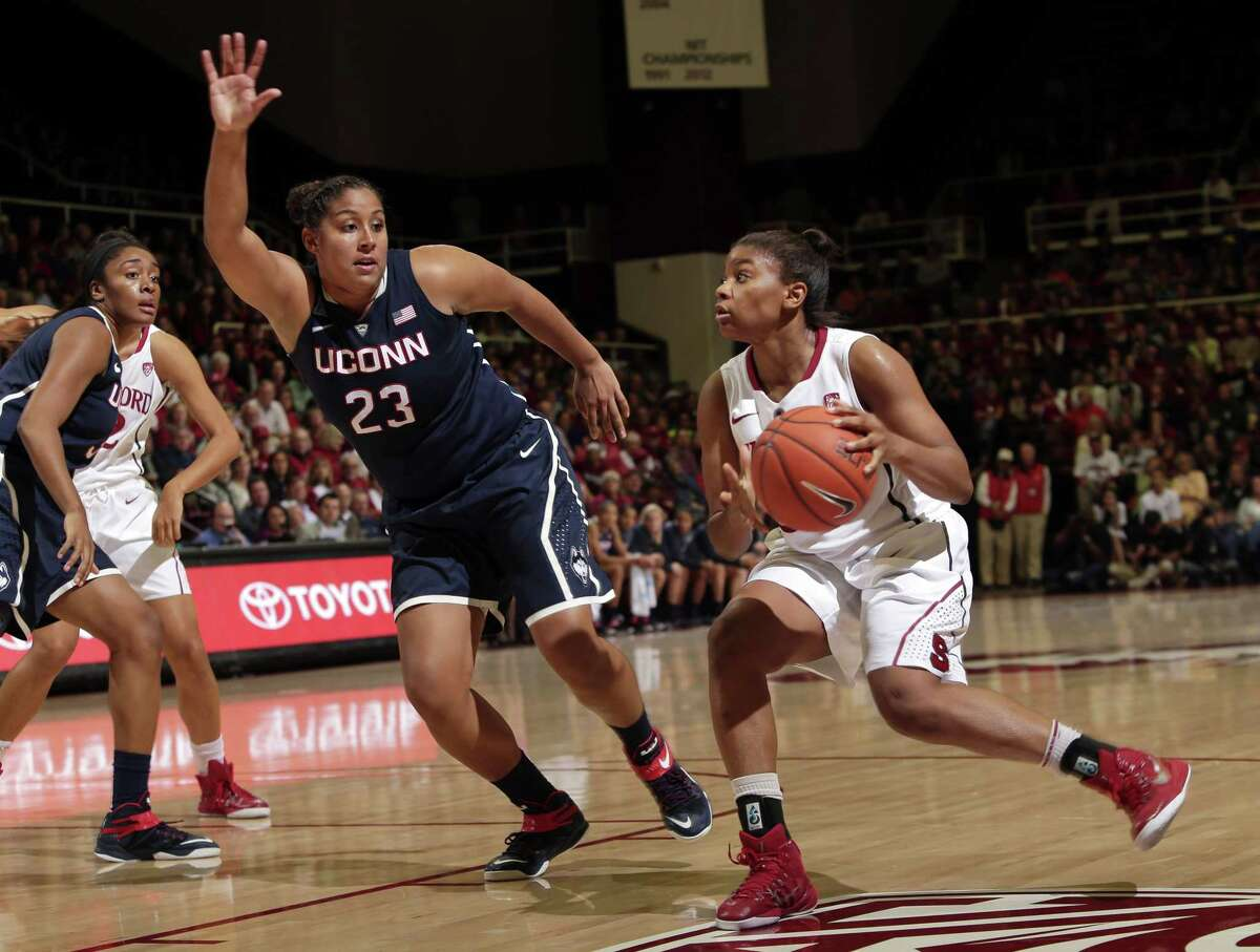 Stanford guard Amber Orrange, right, dribbles next to UConn forward Kaleena Mosqueda-Lewis during the second half of Monday's game in Stanford, Calif. Stanford won 88-86 in overtime.