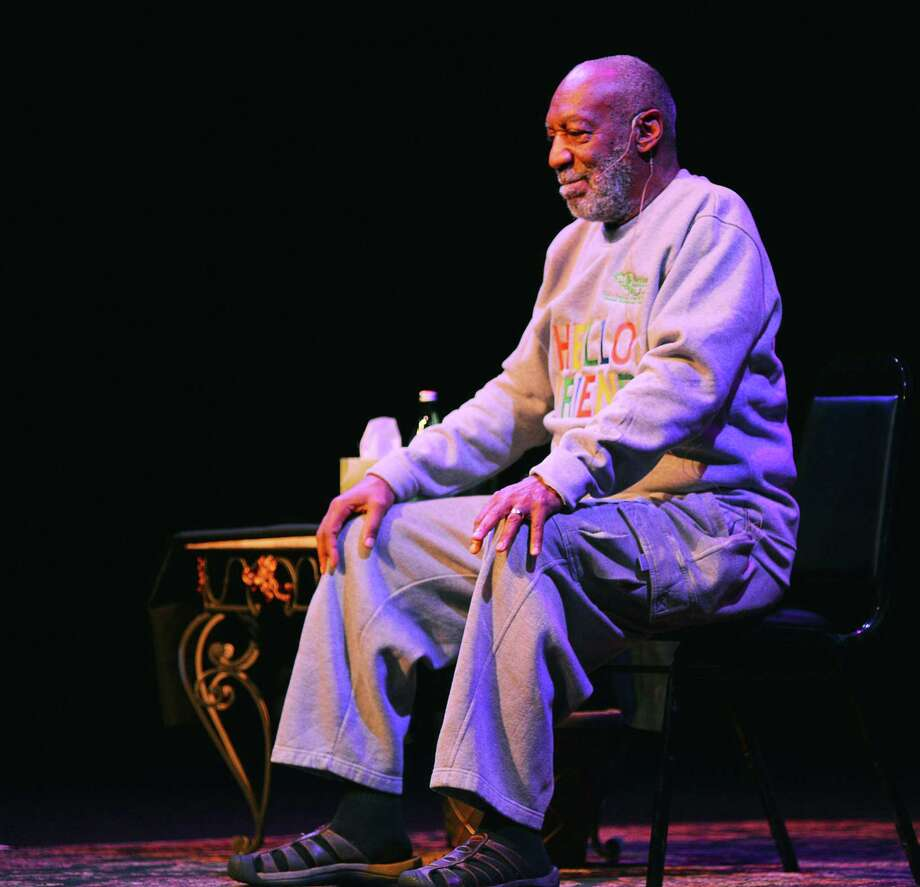 Comedian Bill Cosby performs during a show at the Maxwell C. King Center for the Performing Arts in Melbourne, Fla., Friday, Nov. 21, 2014. Performances by Cosby in Nevada, Illinois, Arizona, South Carolina and Washington state have been canceled as more women come forward accusing the entertainer of sexually assaulting them years ago. (AP Photo/Florida Today, Malcolm Denemark) Photo: AP / Florida Today