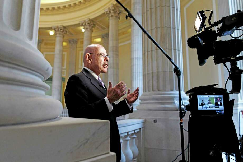 "Retiring Rep. Henry Waxman, D-Calif., a liberal force on health issues who helped write and enact the 2010 Affordable Care Act, defends President Obamaís health care law during a TV news interview on Capitol Hill in Washington, Wednesday, Feb. 5, 2014. Adding fresh fuel to the political fight over ""Obamacare,î Republican lawmakers have seized on a Congressional Budget Office report that predicts nationwide job losses because of the health care program. Photo: (AP Photo/J. Scott Applewhite) / AP"