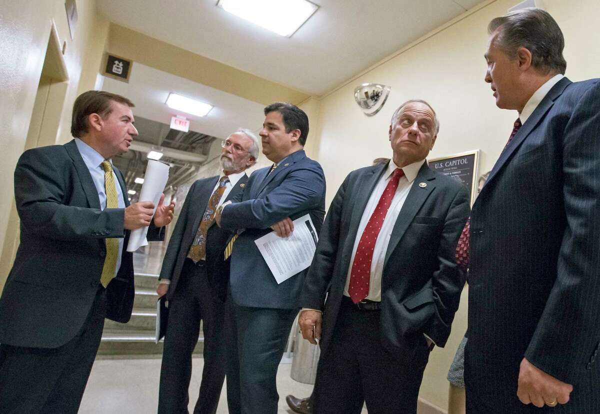 From left, House Foreign Affairs Committee Chairman Rep. Ed Royce, R-Calif., Rep. Dan Newhouse R-Wash., Rep. Raul Labrador, R-Idaho, Rep. Steve King, R-Iowa, and Rep. Trent Franks, R-Ariz., confer on Capitol Hill in Washington, Wednesday, Nov. 18, 2015, following a meeting of the conservative Republican Study Committee ahead of legislation aimed at increasing screenings for Syrian and Iraqi refugees before they enter the U.S., including a requirement for FBI background checks. (AP Photo/J. Scott Applewhite)