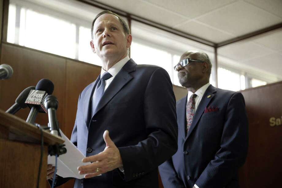 St. Louis Mayor Francis Slay, left, speaks as St. Louis County Executive Charlie A. Dooley listens during a news conference Friday, Nov. 21, 2014, in Clayton, Mo.  Slay and Dooley spoke about preparations as the area waits for a decision from the grand jury whether to indict Ferguson police officer Darren Wilson in the shooting of Michael Brown. (AP Photo/Jeff Roberson) Photo: AP / AP