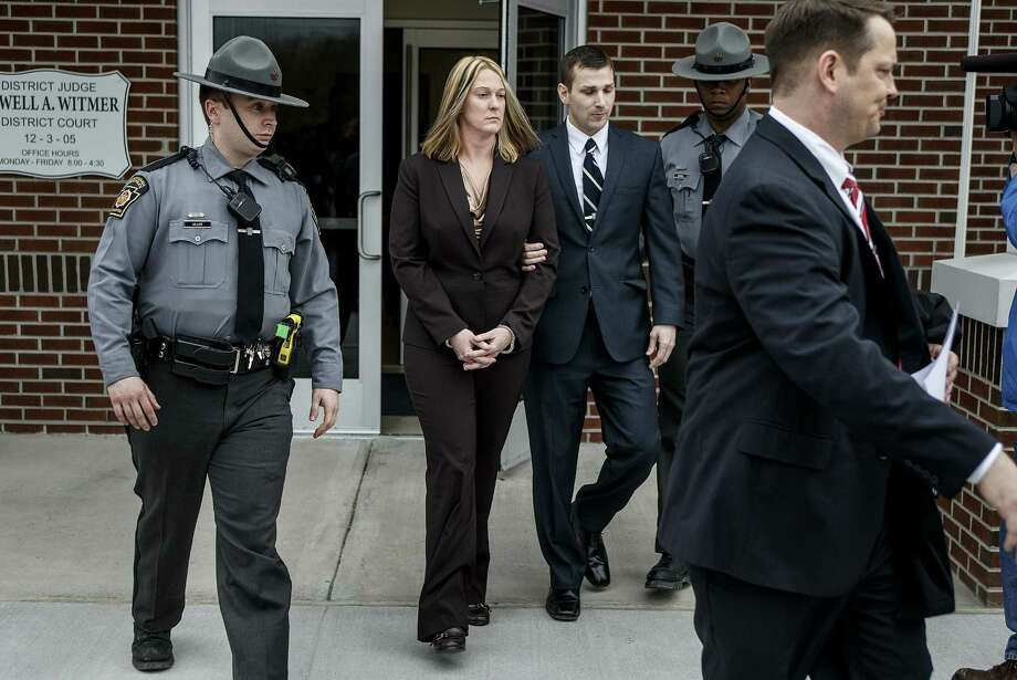 Hummelstown police officer Lisa J. Mearkle is escorted from District Judge Lowell Witmer's office, in West Hanover Township, Pa., after her preliminary arraignment, Tuesday, March 24, 2015, in the fatal shooting of David A. Kassick last month in South Hanover Township. Mearkle was charged Tuesday with criminal homicide after investigators concluded she shot the unarmed motorist in the back as he lay facedown after a traffic stop over an expired inspection sticker. Photo: (AP Photo/PennLive.com, Dan Gleiter) / PennLive.com